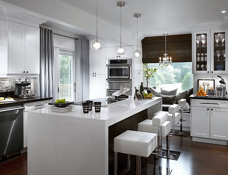 Modern-white-kitchen-with-dark-wood-floor-white-stool-and-handing-lamps-with-gray-drapery